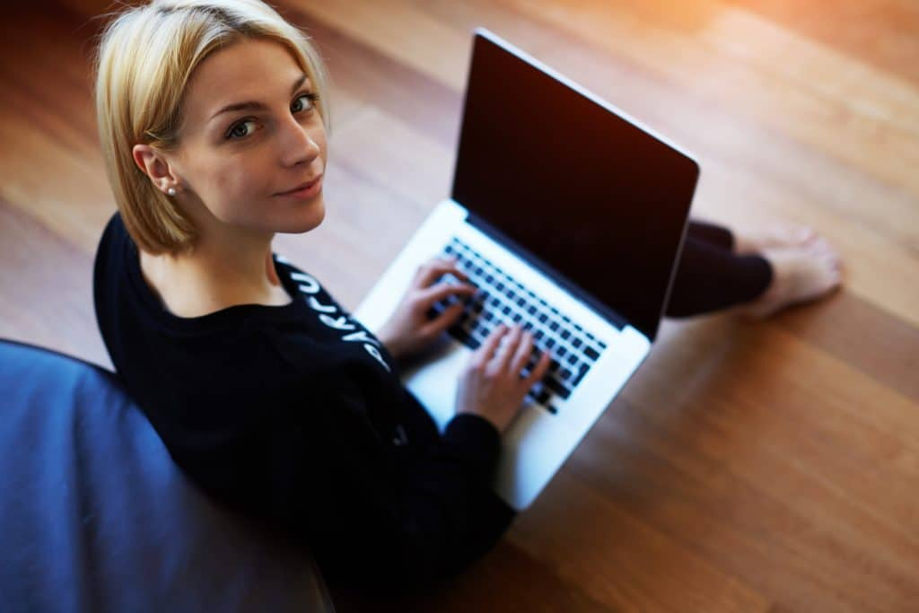 Woman completing an online will