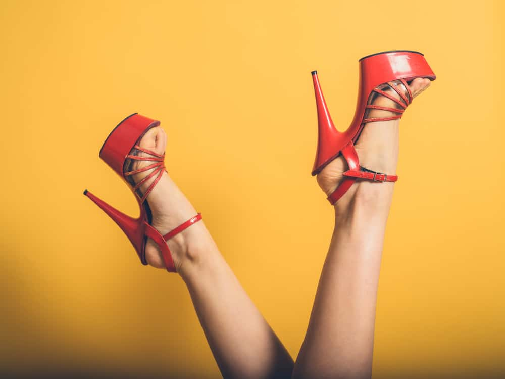 lady's feet in the air wearing red stilleto platform heels.  This is a great position to learn for selling feet pictures