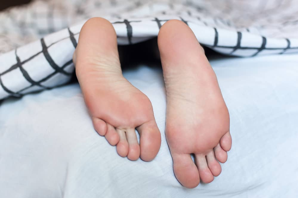 Another position for your feet pics to practise, is your feet sticking out from under the covers