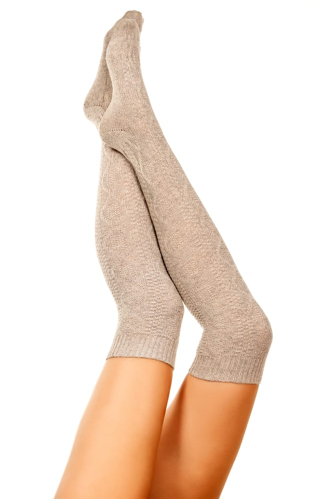 Picutre of a ladies legs with pointing toes. Brown over the knee socks. Take photos of your toes pointing out when you want to sell pictures of feet.